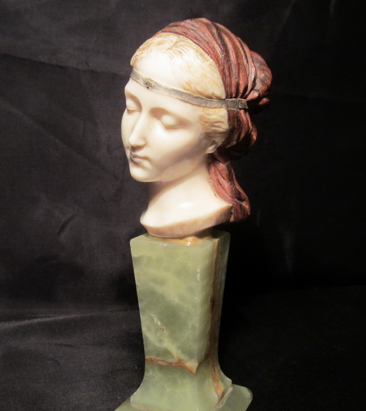 Gorgeous antique ivory and wood head on onyx base. H 18 cm